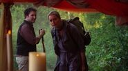 Flynn and Eve entering date tent