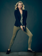Eve Baird with gun season 1 promotional