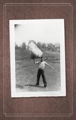 Boy Lifting Boulder - Robert Jackson