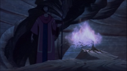 Moses stumbles upon the Burning Bush in a cave