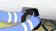 S4E27.076 Mordecai Putting in a New Trailer Tire