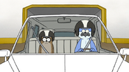 S4E21.121 Mordecai and Rigby Wearing Helmets in the Limo