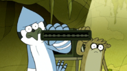 S6E19.171 Mordecai and Rigby Putting in the Cartridge Together