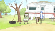 S5E11.027 Muscle Man Shows Mordecai and Rigby a Photo