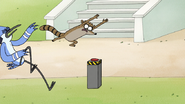 S8E01.027 Rigby Leaping Towards the Button