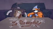 S7E09.328 Mordecai and Rigby Unwrapping the Chocolate Body Parts