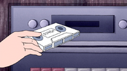 S4E23.072 Donny G inserting the Cassette