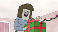 S6E09.033 Muscle Man About to Open the Last Gift