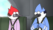 S6E20.183 Mordecai Trying to Remove His Seat Belt