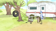 S5E11.058 Muscle Man Lifting a Tire
