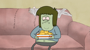 S4E12.050 Muscle Man Holding Some Chicken Nuggets