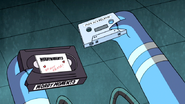 S6E01.183 Mordecai Holding Both Tapes