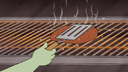 Sh06.008 Muscle Man Grilling a Burger