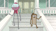 S7E03.175 Benson and Rigby Walking Down the Stairs