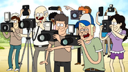S6E22.203 People Laughing and Taking Pictures