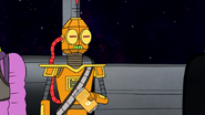 S8E27P1.178 Droid Pulling Out Chips