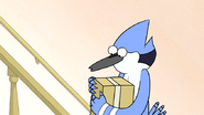 S6E04.182 Mordecai Carrying a Package