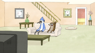 S4E13.018 Mordecai and Rigby Watching the Death Sandwich Commercial