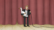 S6E07.009 The Emcee Holding a Goose