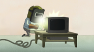S8E19.371 Muscle Man Welding a Cable to the TV
