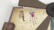 S7E03.151 Rigby and Benson Laying on the Floor