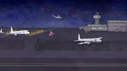 S7E09.186 Pops Driving Into the Airfield