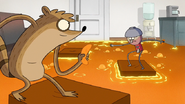 S7E03.140 Rigby and Benson Jumping on the Platforms