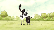 S3E35.143 Mordecai and Rigby Tarred and Feathered