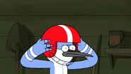 S6E24.107 Mordecai Putting on a Football Helmet