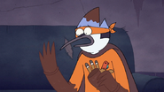 S7E09.337 Mordecai Looking at His Chocolate Arms