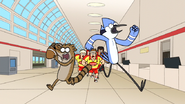S6E13.186 Mordecai and Rigby Being Chased by the Rugby Team