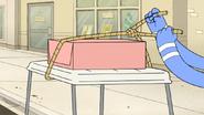 S5E32.028 Mordecai Tying the Cake Down