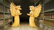 S6E23.115 Two Giant Winged Animal Statues
