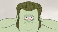 S5E11.114 Muscle Man Applying Hair Gel