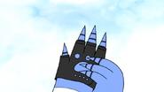 S6E22.172 Mordecai Putting the Fingerless Glove On