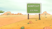 S6E13.067 Airport 300 Km Sign