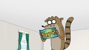 S7E01.017 Rigby Reading the Dumptown USA Postcard