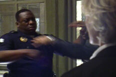 4x01 Black officer holding Vic