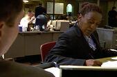3x02 Claudette at desk