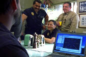 3x12 Hispanic Mark Stone and officer laughing