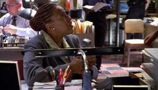 2x06 Claudette at desk