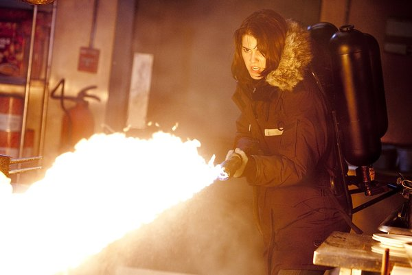 File:Kate Lloyd operates a flamethrower - The Thing (2011).jpg