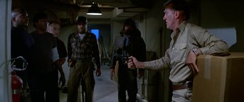 Garry assures the men of his innocence - The Thing (1982)