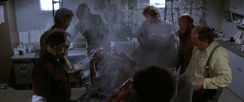 The men examine Split-Face - The Thing (1982)