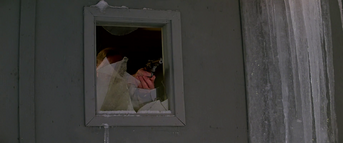 Garry shoots the Norwegian through the window -The Thing (1982).png