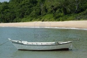 496940-small-white-wooden-fishing-boat-near-the-beach-in-chonburi-province-thailand