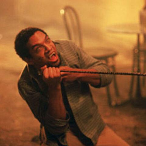 Khary Payton como <i>Kenny</i> en <i>Dracula II</i>.