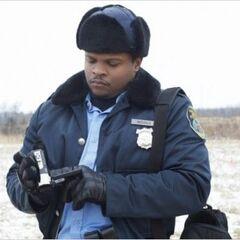 IronE Singleton como Glock Nichols en <i>An Amish Murder</i>