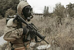 Nuclear-post-apocalypse-survivor-sole-tatters-gas-mask-ruins-destroyed-city-77398707