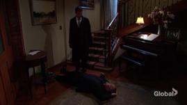 Jack stands over Victor